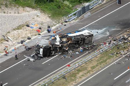Firefighters stand near the debris of bus crash on a motorway in central Croatia June 23, 2012. REUTERS/Pixsell/Handout