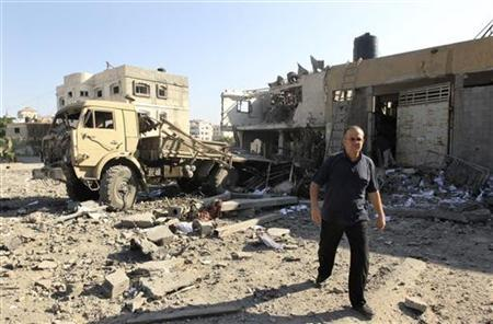A Palestinian man walks past a damaged Hamas security site in Gaza City June 23, 2012. REUTERS/Mohammed Salem