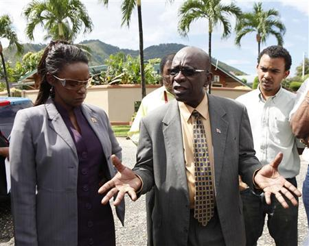 Trinidad and Tobago's Minister of Works and former FIFA Vice President Jack Warner (R) talks to residents during a walkabout in Victoria Gardens, Diego Martin October 12, 2011. REUTERS/Andrea De Silva