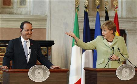 German Chancellor Angela Merkel (R) gestures next to French President Francois Hollande during a news conference at Villa Madama in Rome, June 22, 2012. REUTERS/Max Rossi