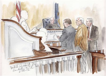 Former Penn State assistant football coach Jerry Sandusky (2nd R) stands with his lawyers as the jury foreman reads the verdict in this courtroom sketch during Sandusky's child sex abuse trial in Bellefonte, PA June 22, 2012. REUTERS/Art Liens