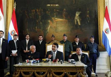 Newly appointed Paraguayan President Federico Franco speaks as he is flanked by Senator Miguel Saguier (L) and Congressman Salustiano Salinas (R) during a news conference at the Presidential Palace surrounded by security officials in Asuncion June 23, 2012. REUTERS/Marcos Brindicci