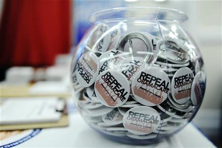 Buttons reading 'Repeal Obamacare' are displayed at the American Conservative Union's annual Conservative Political Action Conference (CPAC) in Washington, February 9, 2012. REUTERS/Jonathan Ernst