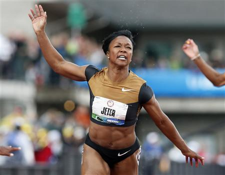 Carmelita Jeter crosses the finish line to win the women's 100 meters at the U.S. Olympic athletics trials in Eugene, Oregon, June 23, 2012. REUTERS/Lucy Nicholson