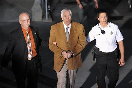 Former Penn State assistant football coach Jerry Sandusky leaves the Centre County Courthouse in handcuffs after his conviction in his child sex abuse trial in Bellefonte, Pennsylvania, June 22, 2012. REUTERS/Pat Little