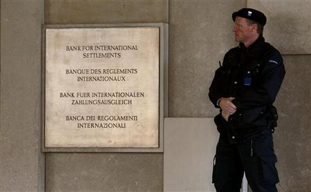 A member of a private security company stands beside a sign in front of the Bank For International Settlements (BIS) in Basel November 8, 2010. REUTERS/Arnd Wiegmann
