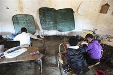 Children write notes from a makeshift black board at a school in Mwezeni village in South Africa's Eastern Cape Province in this picture taken June 5, 2012. REUTERS/Ryan Gray