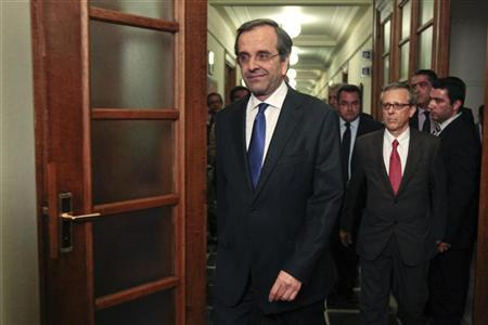 Newly appointed Greek Prime Minister Antonis Samaras arrives for the first cabinet meeting of his government at the parliament in Athens June 21, 2012. REUTERS/Yorgos Karahalis