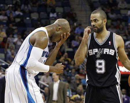 New Orleans Hornets point guard Jarrett Jack (2) puts his head in his hands after being called for a foul, next to San Antonio Spurs point guard Tony Parker (9) during the second half of their NBA basketball game in New Orleans, Louisiana January 23, 2012. REUTERS/Bill Haber