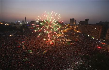 Fireworks explode as supporters of Muslim Brotherhood's presidential candidate Mohamed Morsy celebrate his victory in the election at Tahrir Square in Cairo June 24, 2012. REUTERS/Amr Abdallah Dalsh
