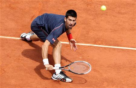 Novak Djokovic of Serbia returns the ball to Rafael Nadal of Spain during their men's singles final match at the French Open tennis tournament at the Roland Garros stadium in Paris June 11, 2012. REUTERS/Francois Lenoir