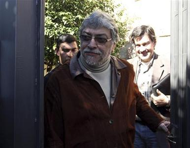Paraguay's ousted President Fernando Lugo walks out of his home to talk to journalists in Lambare, on the outskirts of Asuncion, June 24, 2012. REUTERS/Jorge Adorno