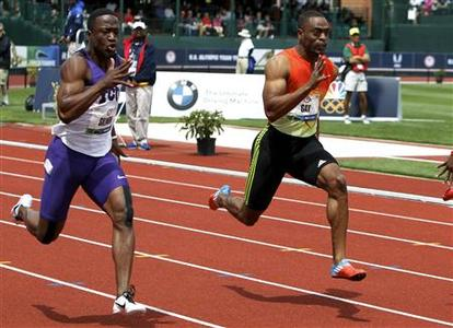 Tyson Gay (R) and Charles Silmon (L) compete in the men's 100 metre semi-final at the U.S. Olympic athletics trials in Eugene, Oregon June 24, 2012. REUTERS/Steve Dipaola