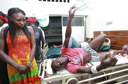 A man injured in a blast at Jerico Pub in the Kenyan Coast waits for treatment at the Coast General Hospital in Mombasa June 24,2012. REUTERS/Joseph Okanga