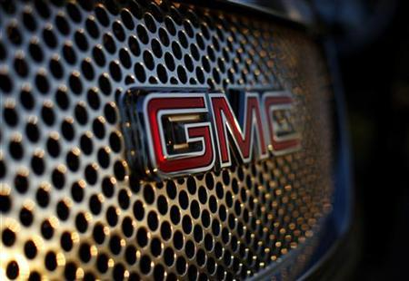 A General Motors logo is seen on a Denali vehicle for sale at the GM dealership in Carlsbad, California January 4, 2012. REUTERS/Mike Blake/Files