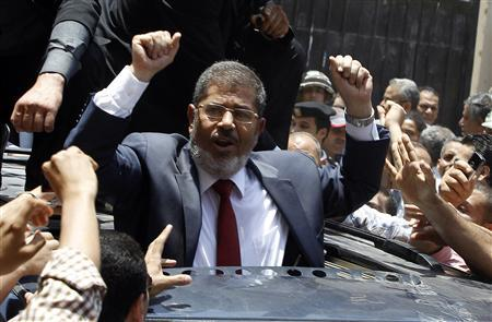 Presidential candidate Mohamed Morsy of the Muslim Brotherhood waves to his supporters after casting his vote at a polling station in a school in Al-Sharqya, 60 km (37 miles) northeast of Cairo in this June 16, 2012 file photo. REUTERS-Ahmed Jadallah-Files