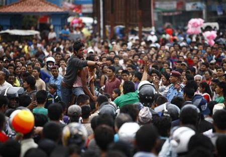 Devotees direct people pulling the chariot during the Bhotojatra festival in Lalitpur June 24, 2012. REUTERS/Navesh Chitrakar