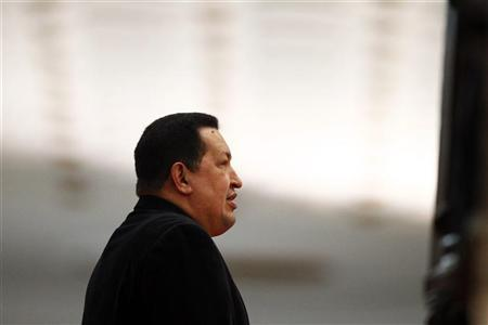 Venezuela's President Hugo Chavez waits to receive his Iranian counterpart Mahmoud Ahmadinejad at Miraflores Palace in Caracas June 22, 2012. REUTERS/Jorge Silva