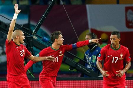 Portugal's Pepe, Cristiano Ronaldo and Nani (L-R) react during their Group B Euro 2012 soccer match at Metalist stadium in Kharkiv, June 17, 2012. REUTERS/Yves Herman