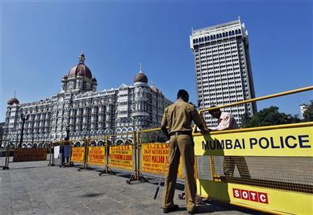 Policemen erect barricades in front of the Taj Mahal Hotel as part of security measures ahead of U.S. President Barack Obama's visit in Mumbai November 4, 2010. REUTERS/Danish Siddiqui/Files