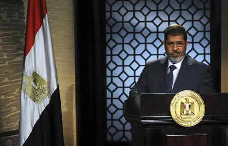 Muslim Brotherhood's president-elect Mohamed Morsy speaks during his first televised address to the nation at the Egyptian Television headquarters in Cairo June 24, 2012. REUTERS/Stringer