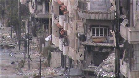 Damaged buildings are seen in Homs June 23, 2012. REUTERS/Shaam News Network/Handout