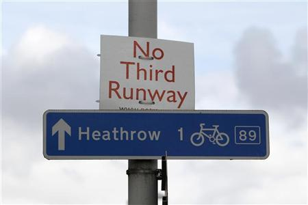 A protest sign is attached to a lampost in Sipson, near Heathrow airport west of London March 26, 2010. REUTERS/Suzanne Plunkett
