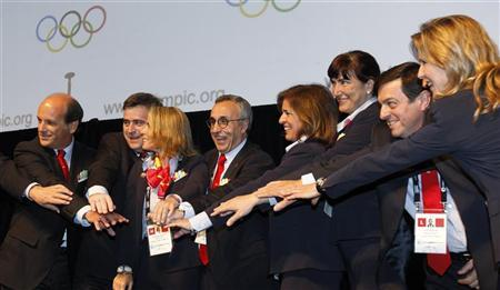 Members of the Madrid delegation pose after the announcement of the candidate cities for the 2020 summer Olympics at the SportAccord convention at the Congress Center in Quebec City, May 23, 2012. REUTERS/Mathieu Belanger