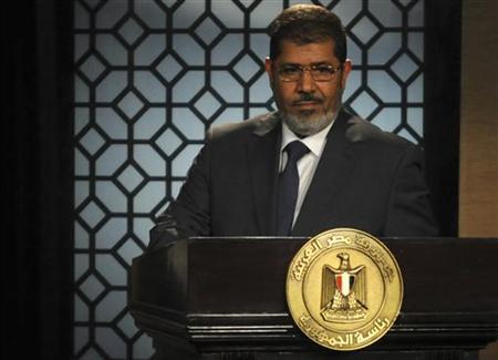Egypt's President-elect Mohamed Mursi speaks during his first televised address to the nation at the Egyptian Television headquarters in Cairo June 24, 2012. REUTERS/Stringer