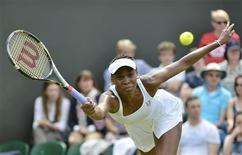 Venus Williams of the U.S. hits a return to Elena Vesnina of Russia during their women's singles tennis match at the Wimbledon tennis championships in London June 25, 2012. REUTERS/Toby Melville