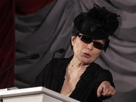 Artist Yoko Ono reacts as she receives the 2012 Oskar Kokoschka Award in Vienna March 1, 2012. REUTERS/Herwig Prammer