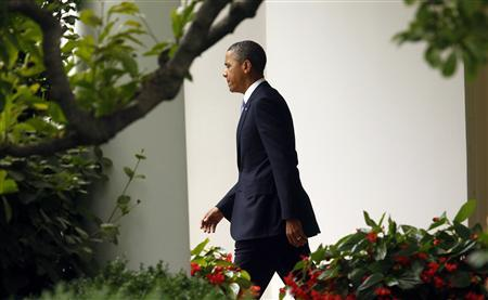 U.S. President Barack Obama departs the White House in Washington June 25, 2012. REUTERS/Kevin Lamarque