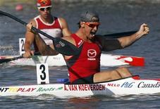 Adam Van Koeverden (front) of Canada celebrates winning the men's K1 1000m final during the ICF Canoe and Kayak Sprint World Championships in Szeged, 170km (106 miles) south of Budapest, August 19, 2011. REUTERS/Laszlo Balogh