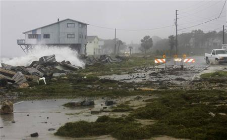A truck takes a detour along Alligator Drive after Tropical Storm Debby washed out a section of the road in Alligator Point, Florida June 25, 2012. REUTERS/Phil Sears