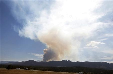 The Waldo Canyon fire sends up a smoke plume, which can be seen for miles, outside Colorado Springs, Colorado June 25, 2012. REUTERS/Rick Wilking
