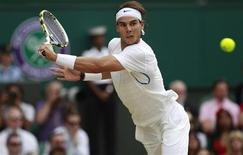 Rafael Nadal of Spain hits a return to Novak Djokovic of Serbia during their men's singles final match at the Wimbledon tennis championships in London July 3, 2011. REUTERS/Eddie Keogh