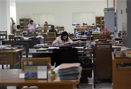 Employees work at the Myanmar central bank's headquarters in Naypyitaw May 17, 2012. REUTERS/Soe Zeya Tun
