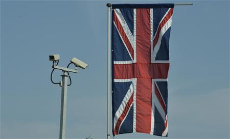 Security cameras and a British Union flag are seen in London in this March 29, 2012 file photo. REUTERS/Toby Melville