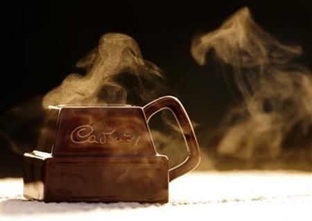 Steam rises from a mug bearing the Cadbury logo in this photo illustration taken in Pitlochry, Scotland February 2, 2010. REUTERS/Russell Cheyne