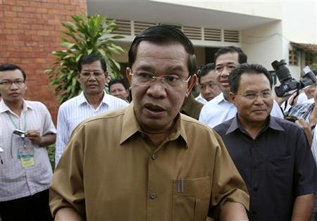 Cambodia's Prime Minister Hun Sen (C) talks to the media during a local commune election in Kandal province June 3, 2012. REUTERS/Samrang Pring