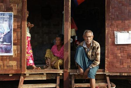 Ethnic Kachin people sit in the doorways of shelters at a temporary camp for people displaced by fighting between government troops and the Kachin Independence Army, or KIA, outside the city of Myitkyina in the north of the country, February 22, 2012. At the same time, thousands of local people have fled to Chinese border and bigger towns inside the Kachin State to escape the battles. REUTERS/Soe Zeya Tun