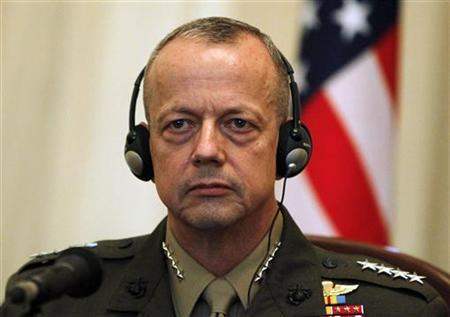 U.S. General John Allen, NATO's commander of foreign troops in Afghanistan, listens to a speech by Afghan Defence Minister Abdul Rahim Wardak during a ceremony to sign an agreement in Kabul April 8, 2012. REUTERS/Omar Sobhani