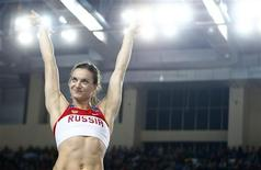 Yelena Isinbayeva of Russia greets spectators during the women's pole vault final during the world indoor athletics championships at the Atakoy Athletics Arena in Istanbul March 11, 2012. REUTERS/Kai Pfaffenbach