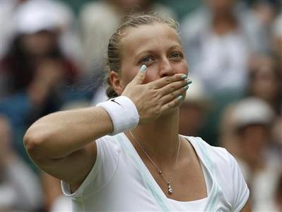 Petra Kvitova of the Czech Republic celebrates after defeating Akgul Amanmuradova of Uzbekistan in their women's singles tennis match at the Wimbledon tennis championships in London June 26, 2012. REUTERS/Stefan Wermuth