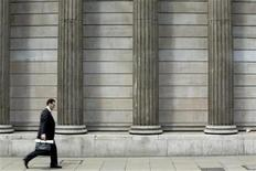 A man walks through the financial district in the City of London June 22, 2012. REUTERS/Neil Hall