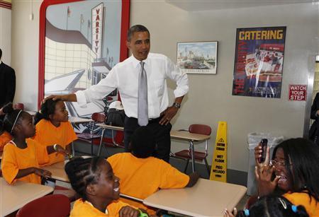 U.S. President Barack Obama talks to children inside the Varsity restaurant in Atlanta, Georgia, June 26, 2012. REUTERS/Larry Downing