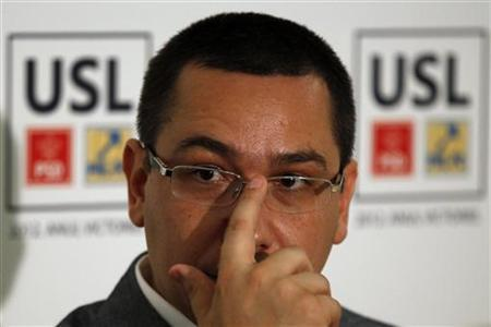 Romania's Prime Minister and Social Liberal Union (USL) alliance leader Victor Ponta gestures during a news conference after the first exit polls in local elections in Bucharest June 10, 2012. REUTERS/Bogdan Cristel