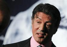"""Actor Sylvester Stallone poses during a photo call promoting his new movie """"The Expendables"""" in Berlin, in this August 6, 2010 file photo. REUTERS/Thomas Peter/Files"""