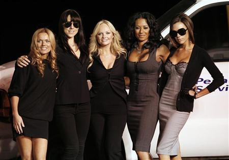 The Spice Girls (L-R) Geri Halliwell, Melanie Chisholm, Emma Bunton, Melanie Brown and Victoria Beckham pose after unveiling a Virgin Atlantic Boeing 747 plane named ''Spice One'' in honor of the pop group at Los Angeles international airport on December 12, 2007. REUTERS/Mario Anzuoni