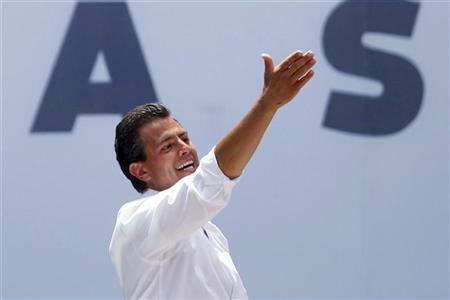 Enrique Pena Nieto, presidential candidate of the opposition Institutional Revolutionary Party (PRI), gestures during his arrival to attend a rally at the Azteca stadium in Mexico City June 24, 2012. REUTERS/Edgard Garrido